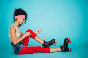 Young girl with roller skates isolated