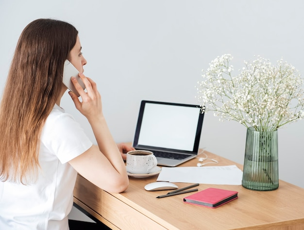 Young girl working at home office at the table