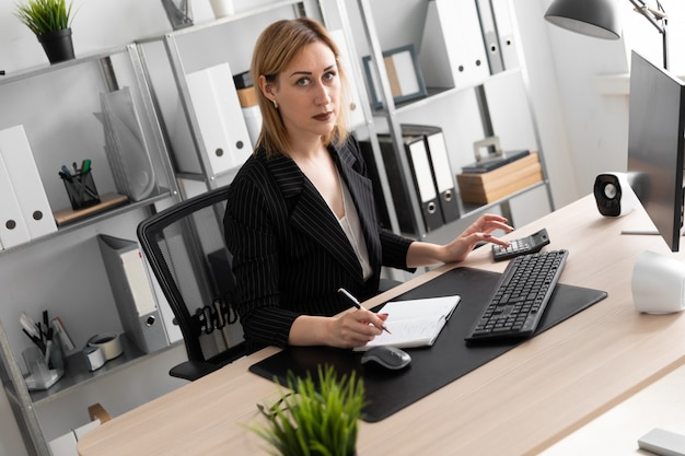 Young girl working in the office.
