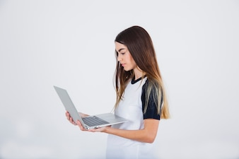 Young girl working with her lap top