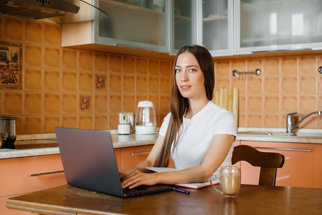 A young girl works at home on remote site. distance learning. stay at home.