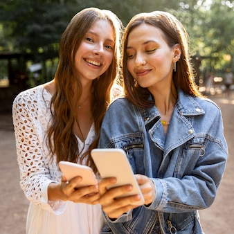 Young girlfriends with mobile