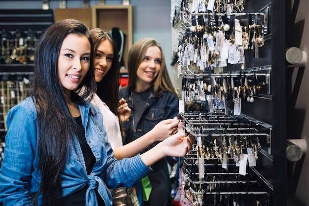 Young girls in bijouterie shop