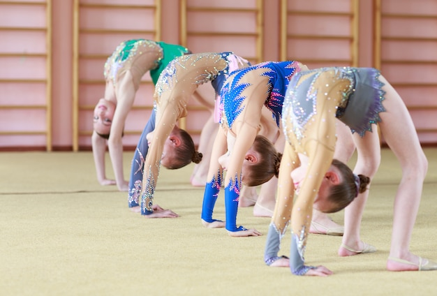 Young girls doing gymnastics.