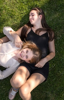Young girls having fun on the grass