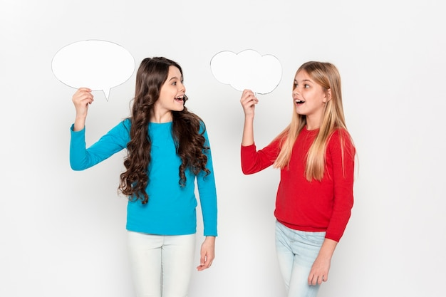 Young girls holding bubble chat