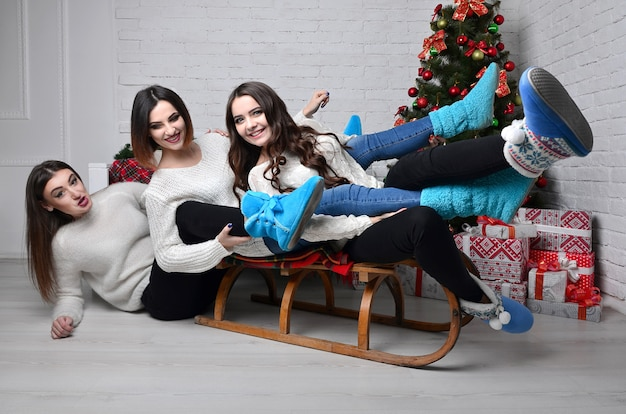 Young girls with sleigh