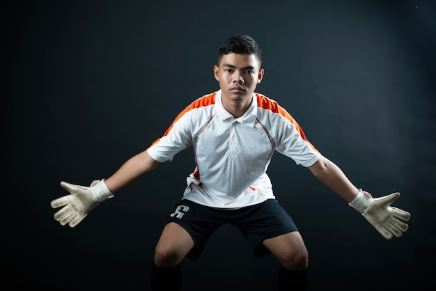 Young goalkeeper soccer man isolated of academy soccer team