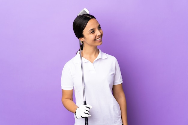 Young golfer woman over isolated colorful background happy and smiling