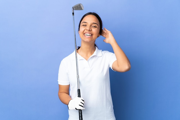Young golfer woman over isolated colorful background laughing