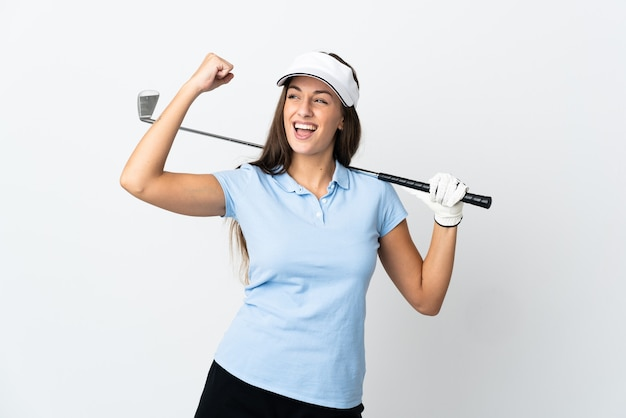 Young golfer woman over isolated white background celebrating a victory