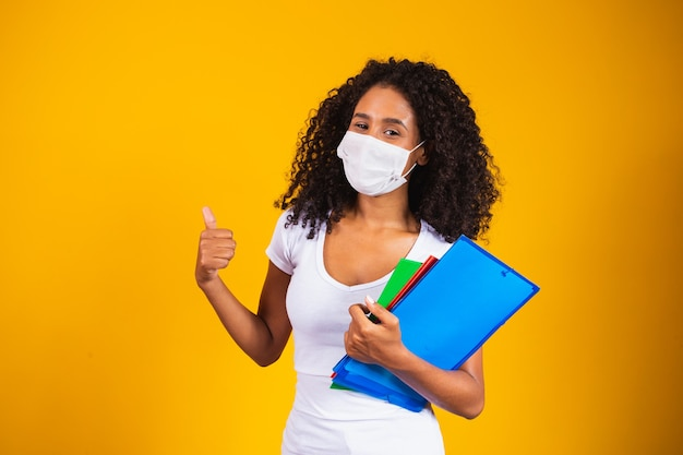 Young graduate or high school student wearing surgical mask against covid 19. new normal and education concept