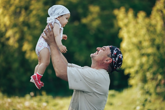 Young grandfather playing with adorable baby girl