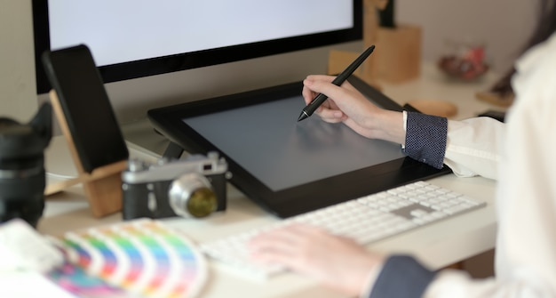 Young graphic designer drawing