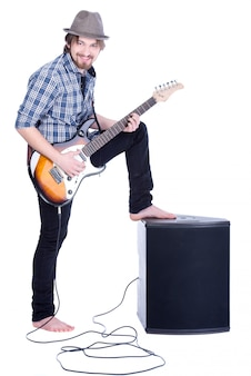 Young guitarist plays on the electric guitar.