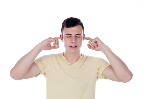 Young guy covering his ears