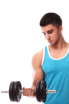 Young guy doing exercises with dumbbell