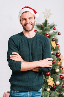 Young guy near Christmas tree