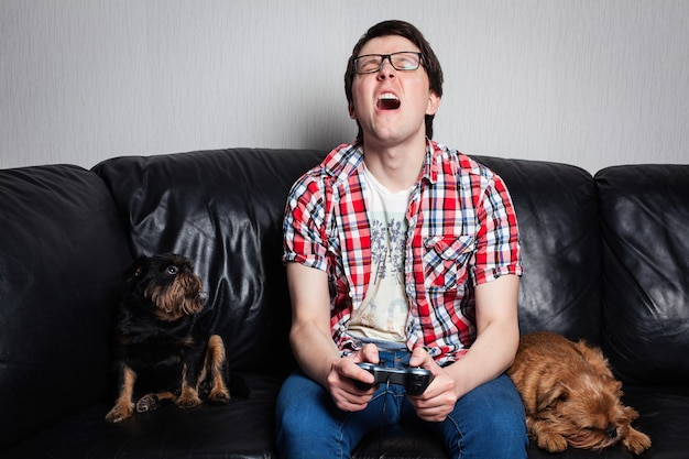 Young guy playing video games.