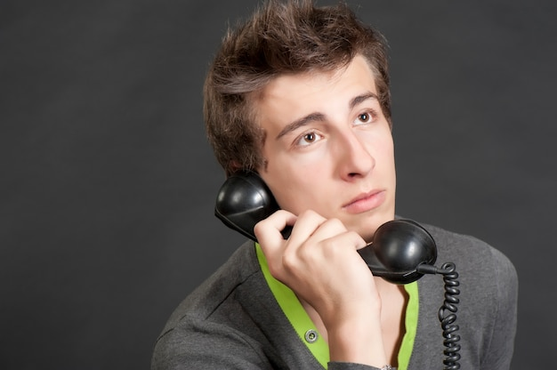 Young guy talking on the old phone