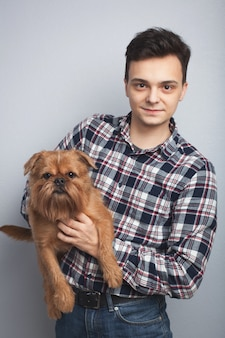 Young guy with his dog.