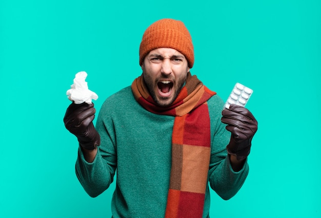 Young handome man with pills tablet. illness, flu or cough concept