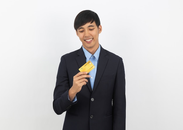 Young handsome asian business man holding and looking to credit card