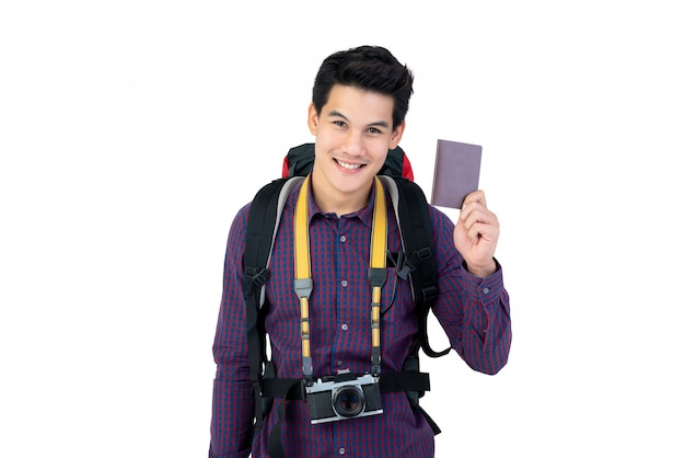Young handsome asian man holding passport enjoying having holidays