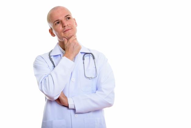 若いハンサムなハゲ男医師見ながら考えて