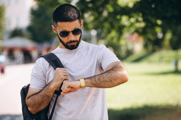 Young handsome bearded man student