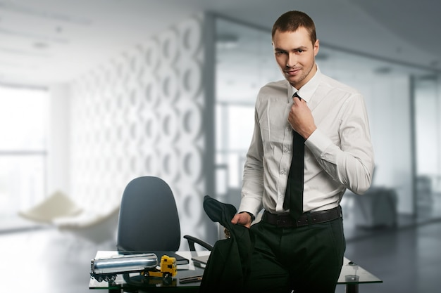 Young handsome business man on a desk