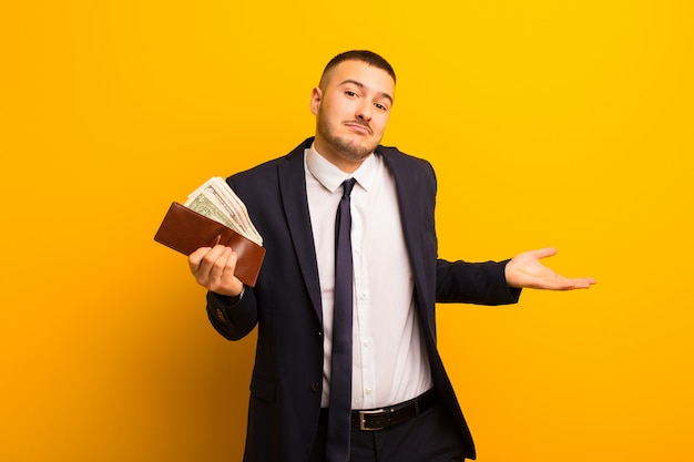 Young handsome businessman  against flat background money concept