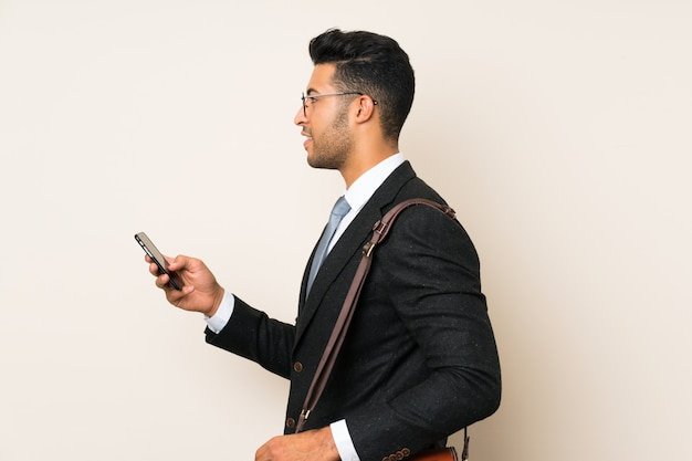 Young handsome businessman man over isolated background