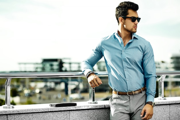 Young handsome businessman model man in casual cloth in sunglasses in the street