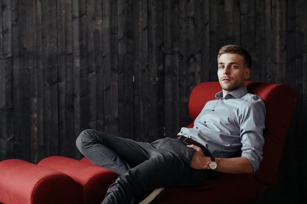 Young handsome businessman posing indoor