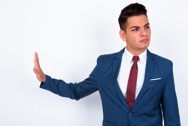 Young handsome businessman wearing blue suit on white