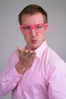 Young handsome businessman with pink shirt