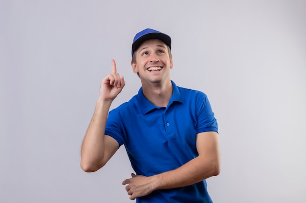 Young handsome delivery man in blue uniform and cap