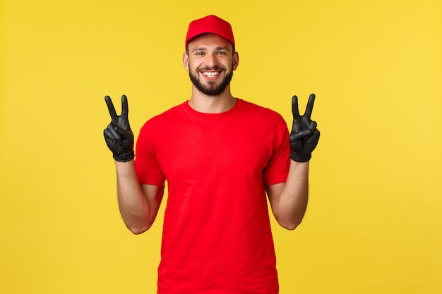 Young handsome delivery man with a red cap