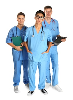 Young handsome doctors on white surface