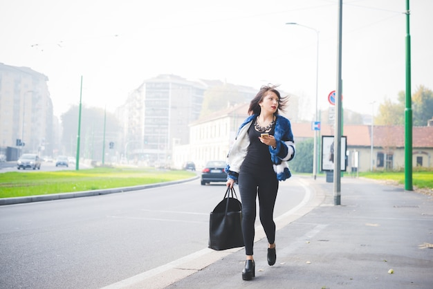 Young handsome eastern woman walking outdoor in the city