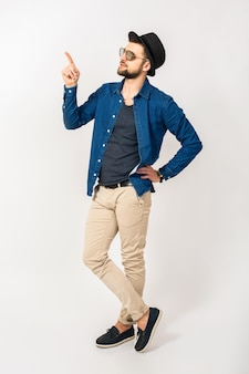 Young handsome hipster man pointing finger