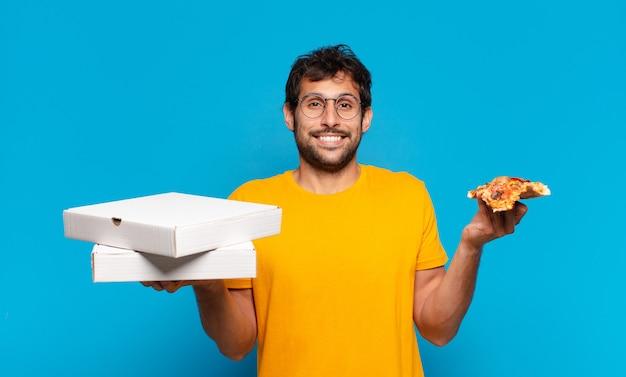 若いハンサムなインド人の幸せな表情と持ち帰りピザ