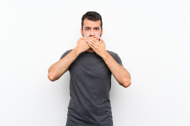 Young handsome man  covering mouth with hands