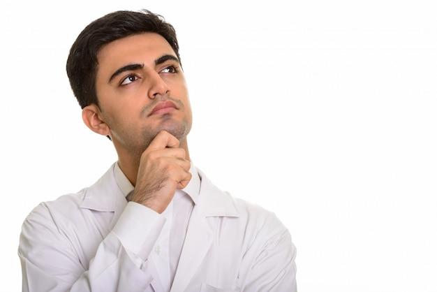 若いハンサムな男医師思考と見上げる
