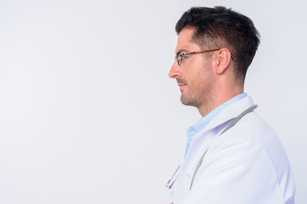 Young handsome man doctor wearing eyeglasses isolated against white wall