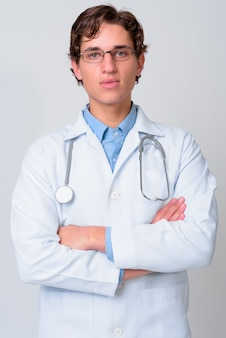 Young handsome man doctor wearing eyeglasses