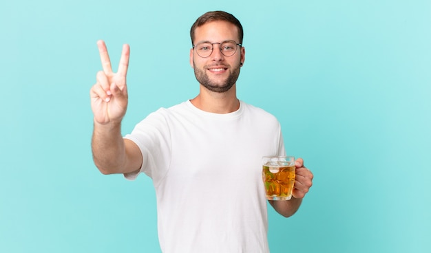 Young handsome man drinking a pint of beer