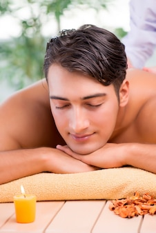 Young handsome man during spa procedure