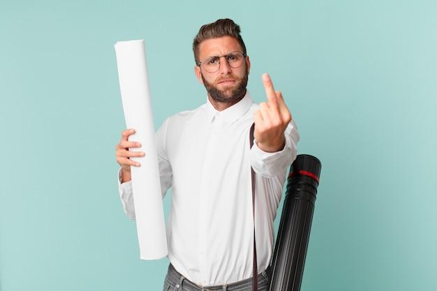 怒り、イライラ、反抗的、攻撃的な若いハンサムな男。建築家の概念